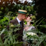Tattoo bride and groom kissing at Longueville House wedding
