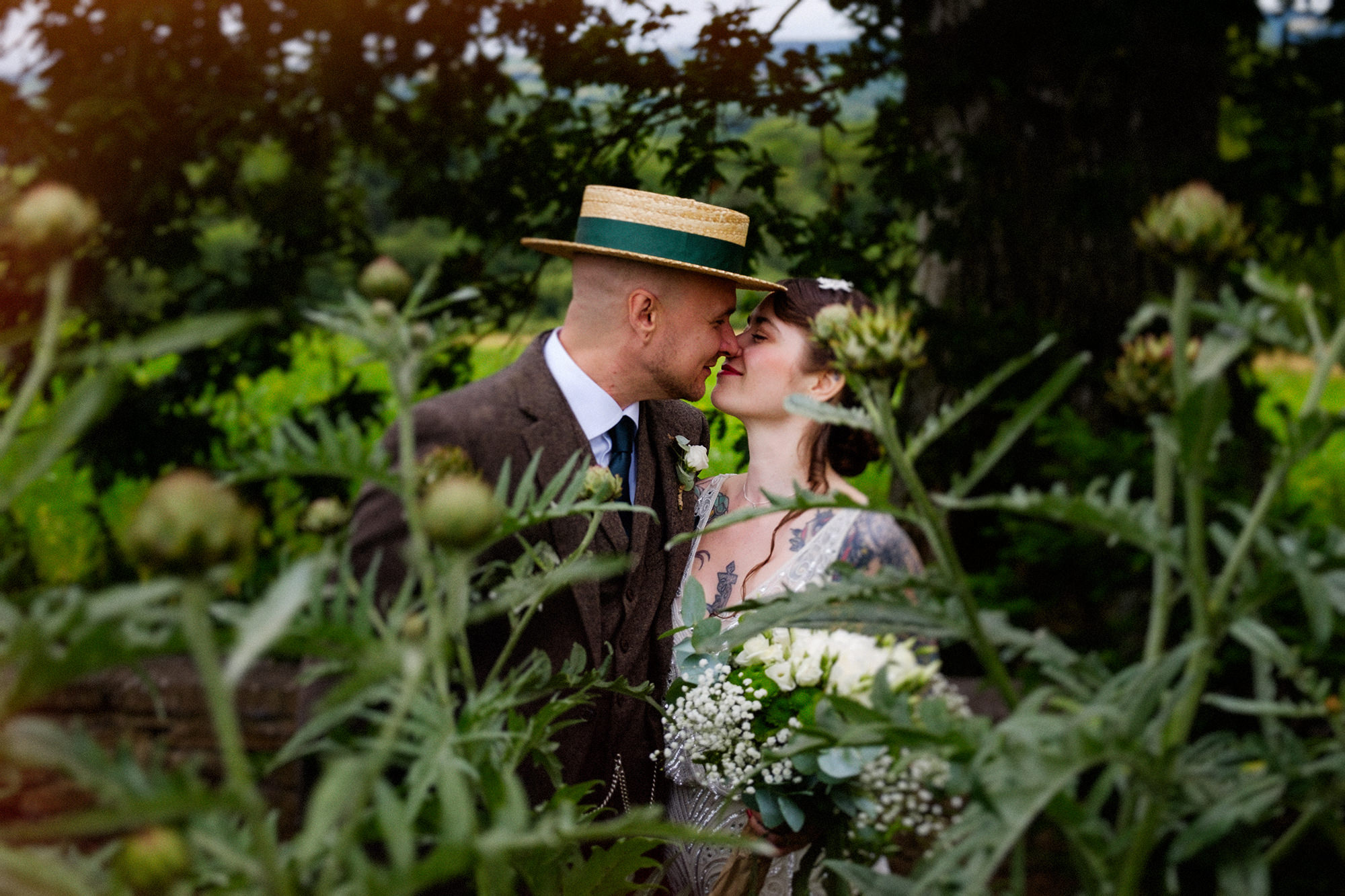 bride and groom kiss Longueville House