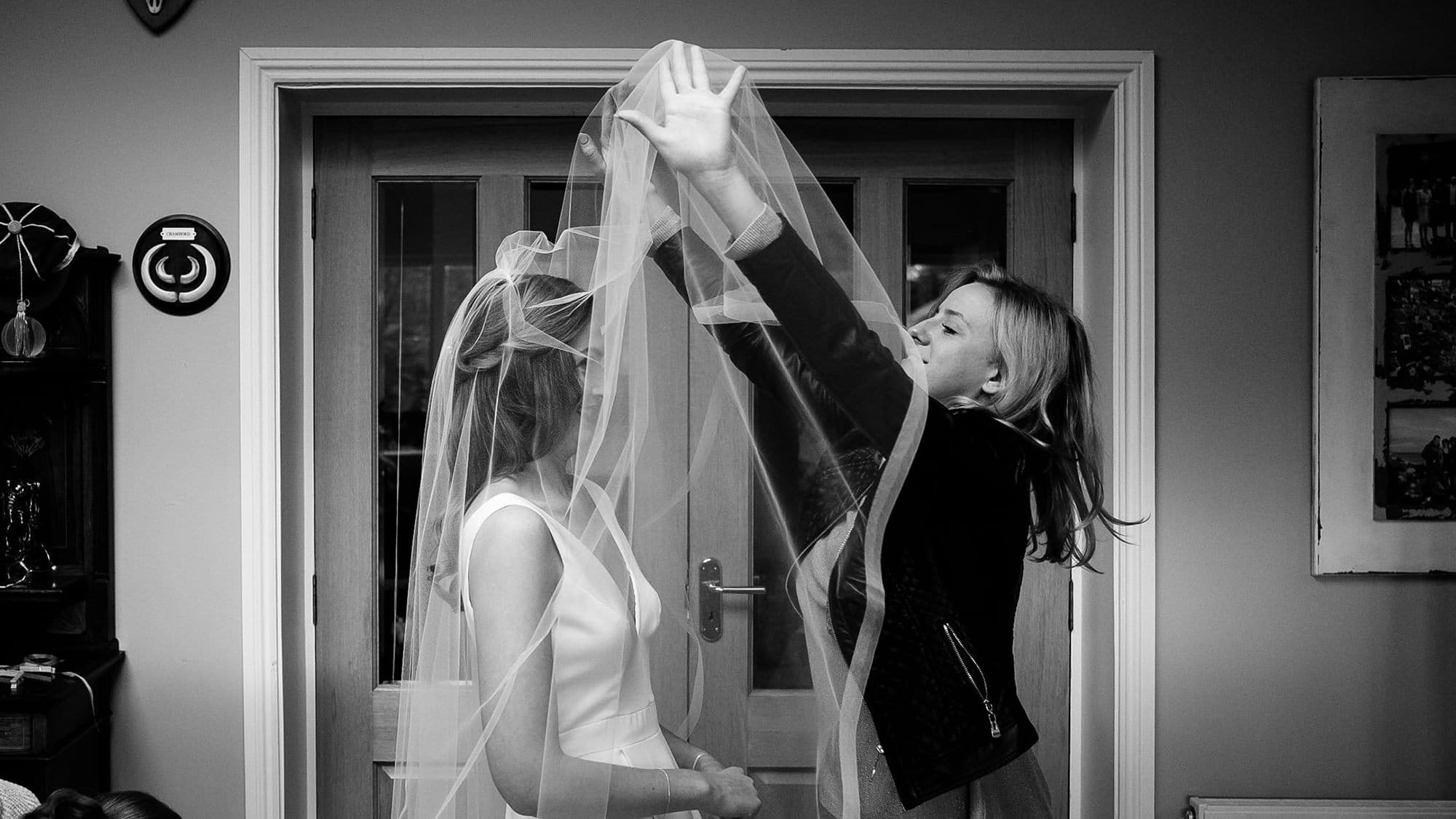 veil being put on bride
