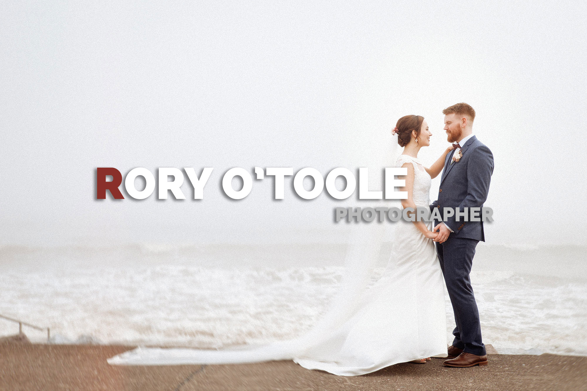 Misty sea with bride and groom