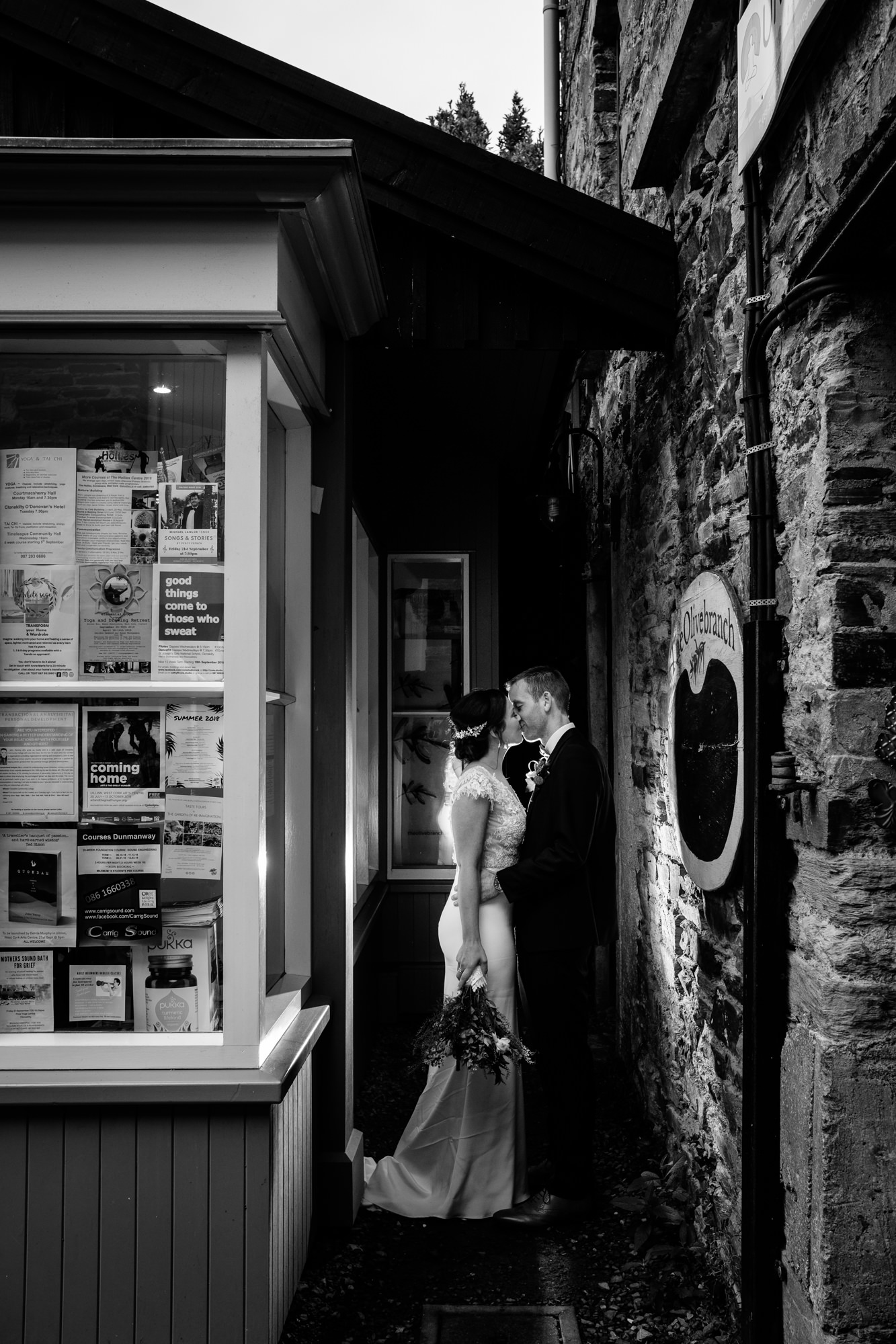Bride and groom kiss in alley way in Clonakilty off camera flash wedding photography