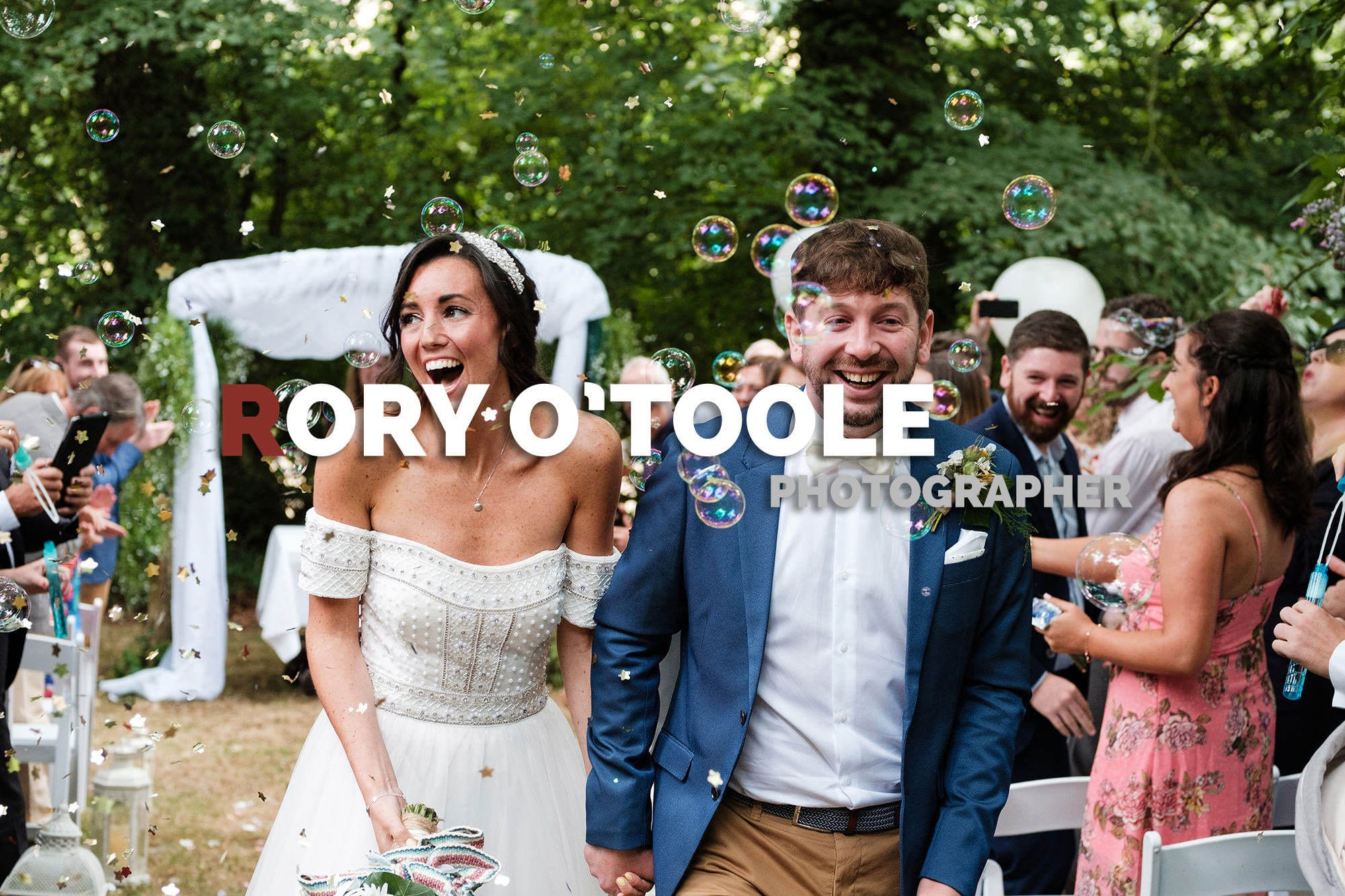 bride and groom and bubbles and laughter