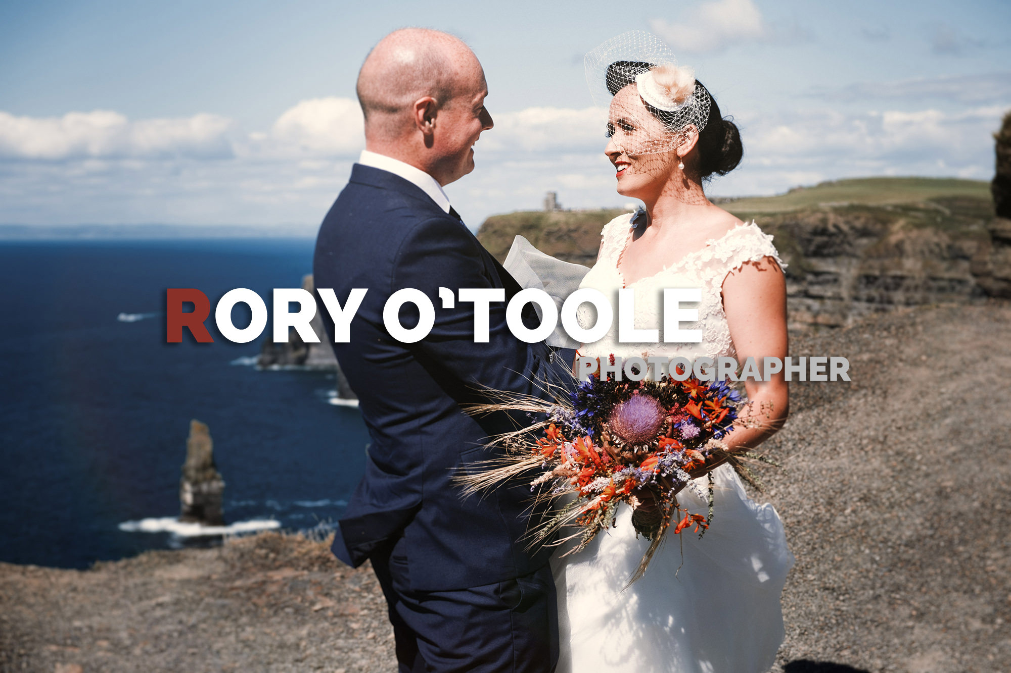 Vintage bride and groom at the Cliffs of Moher