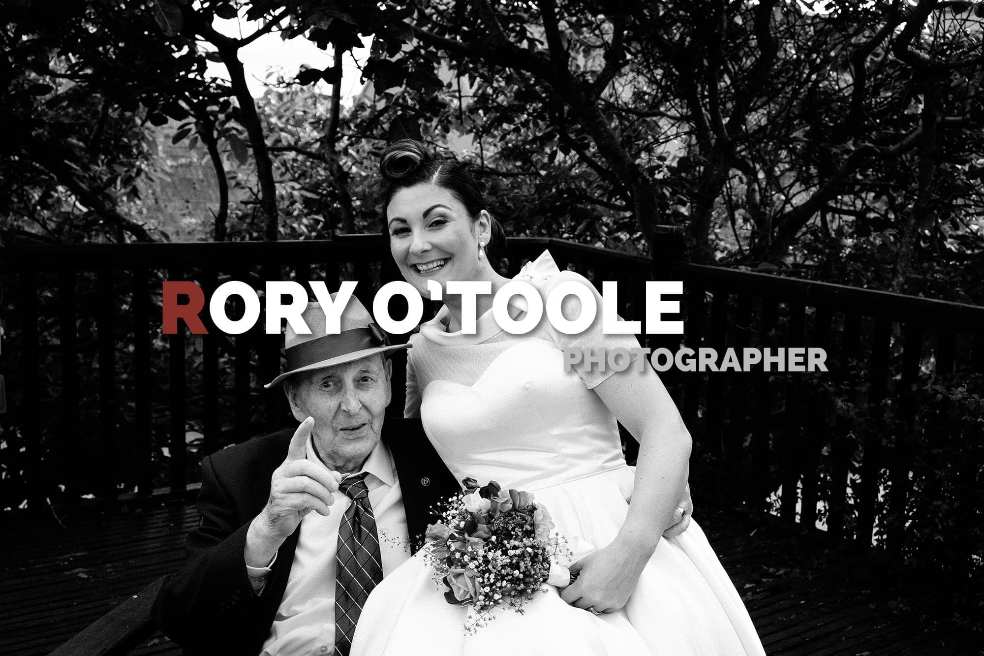 old man pointing at camera with bride