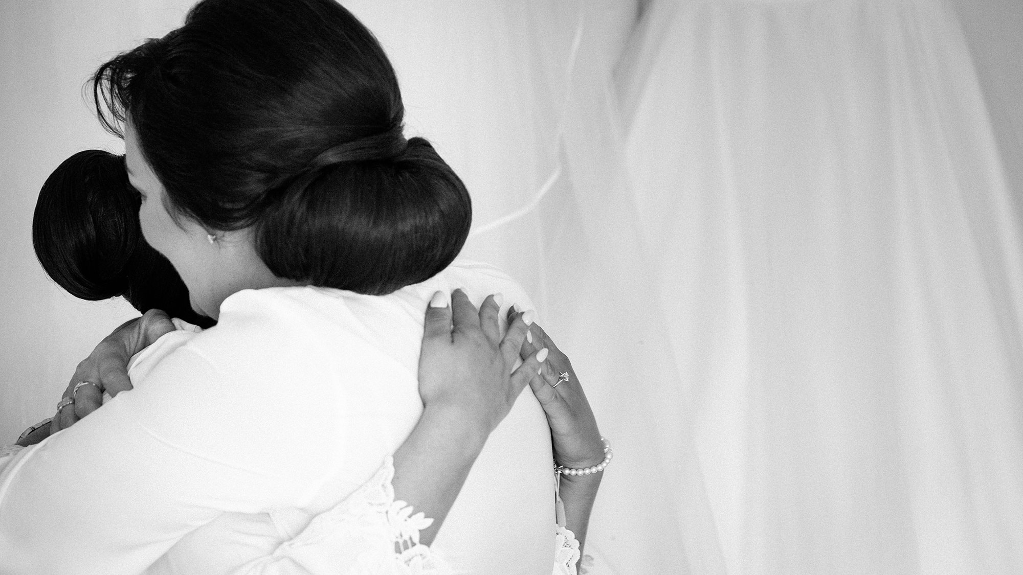 mother of bride hugging daughter on wedding morning