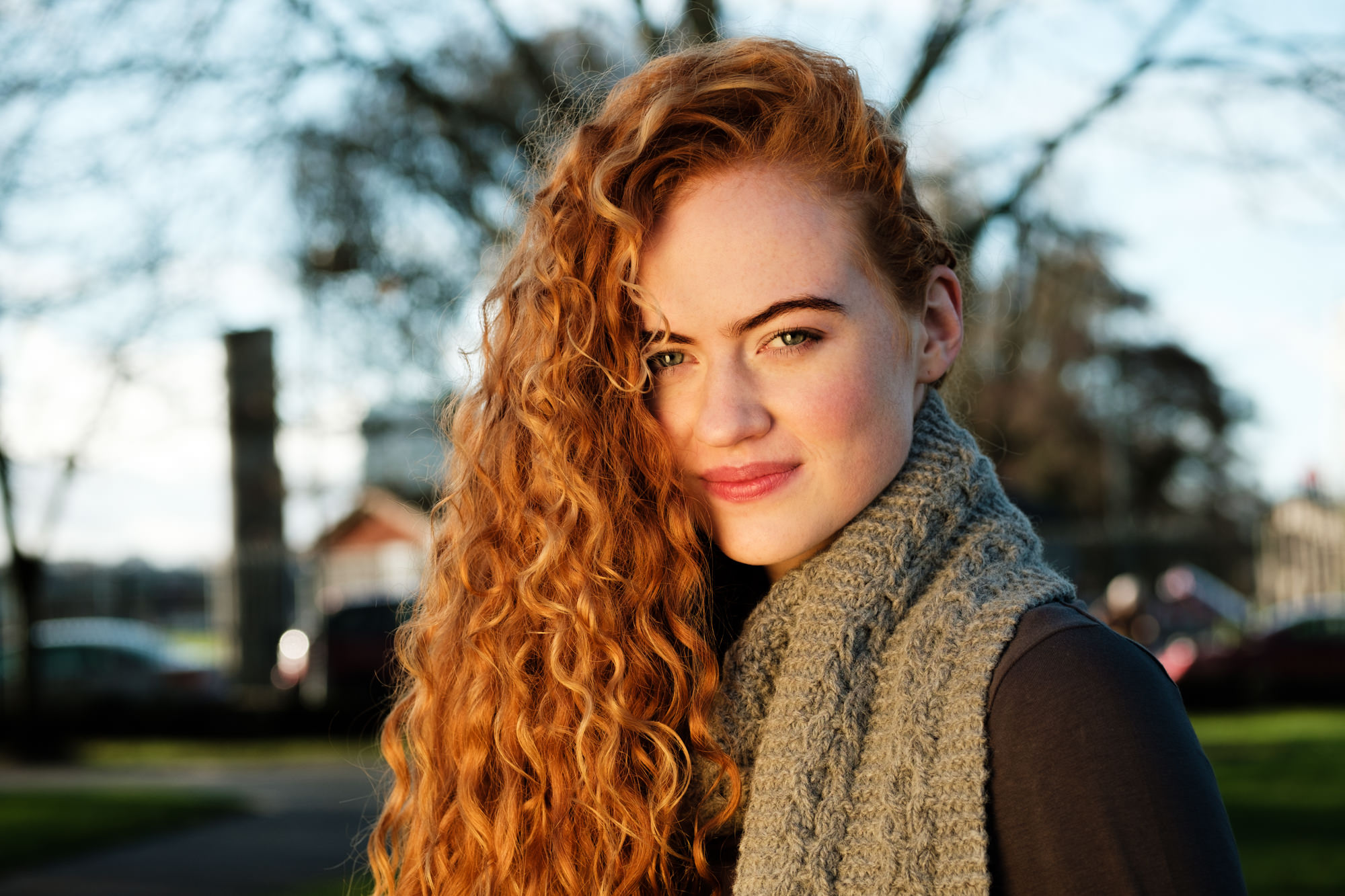 Irish model with long red hair wearing 100% Irish wool scarf by Yarn Vibes in Ireland