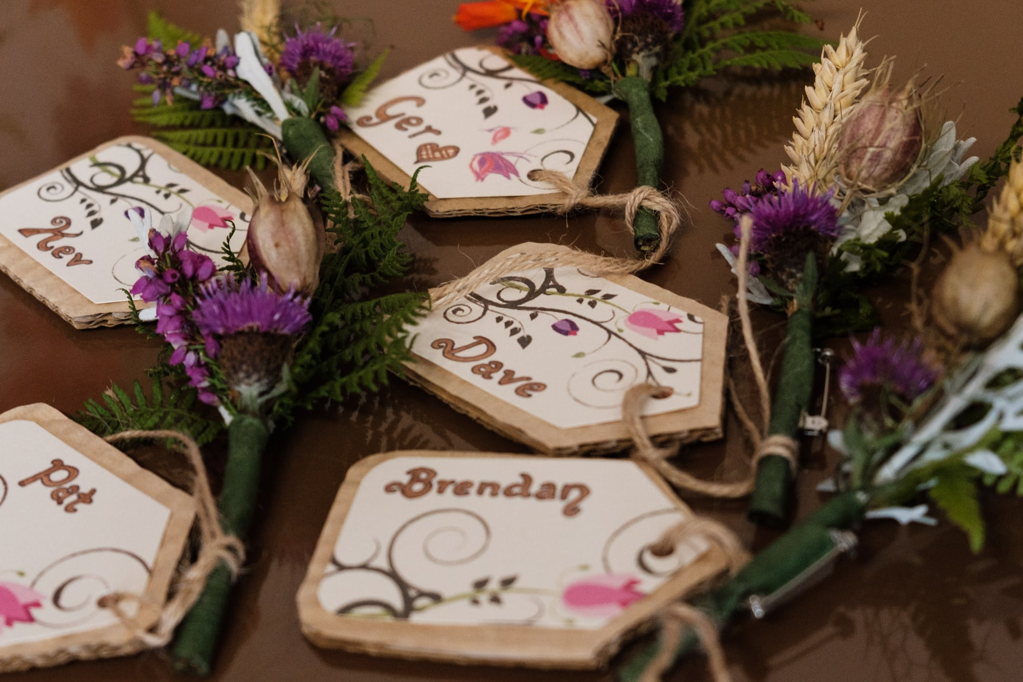 Groomsmens flowers and name tags
