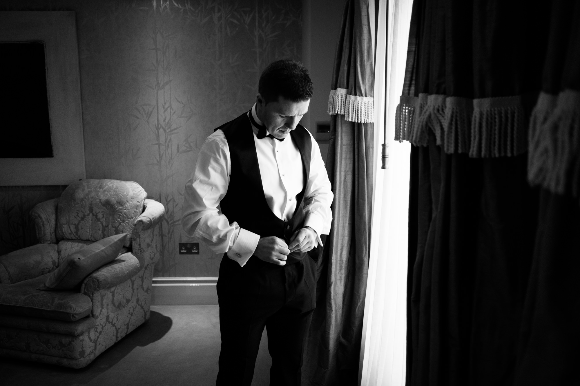 groom-dressing-blackandwhite