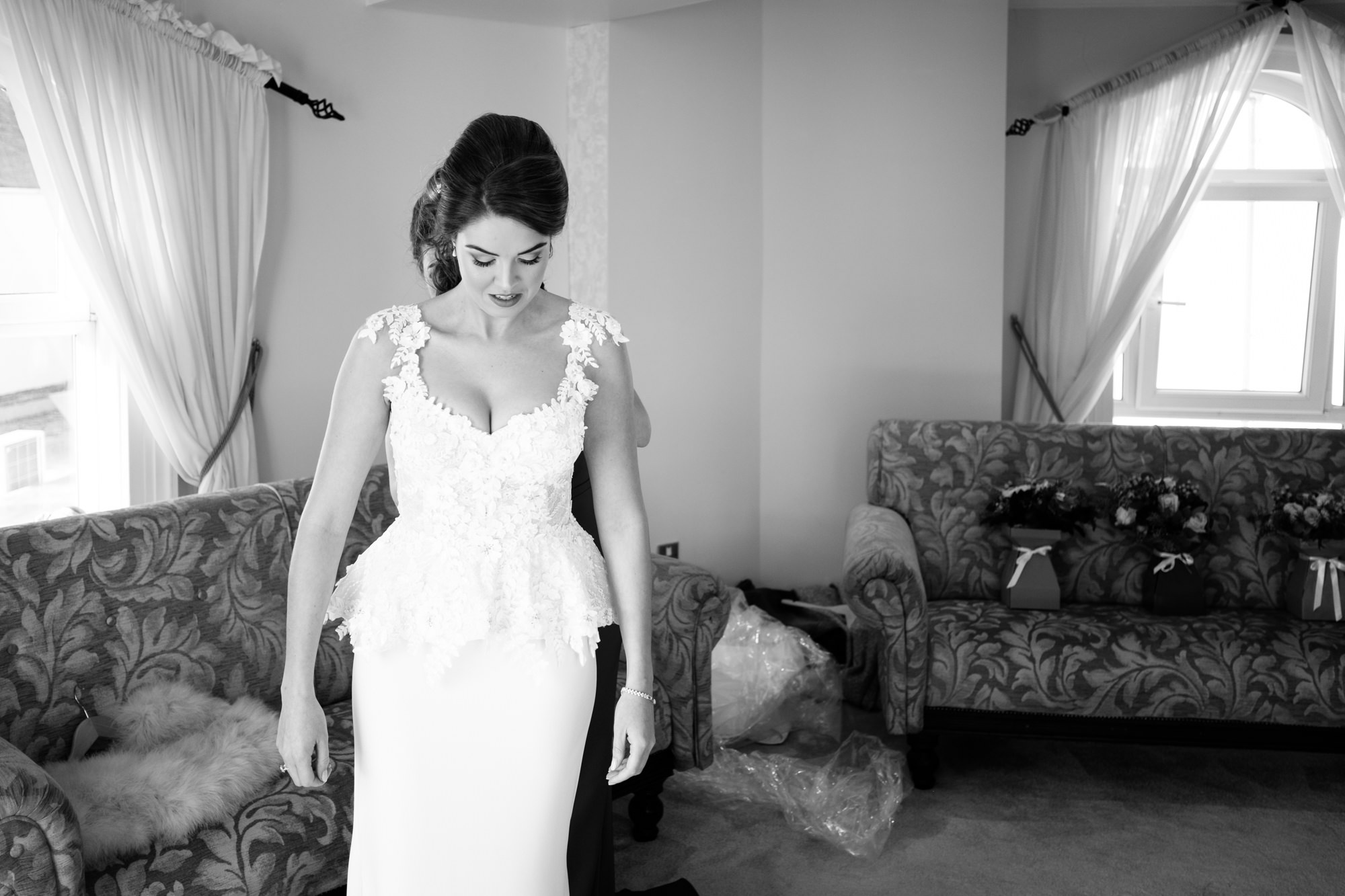 bride-getting-into-wedding-dress