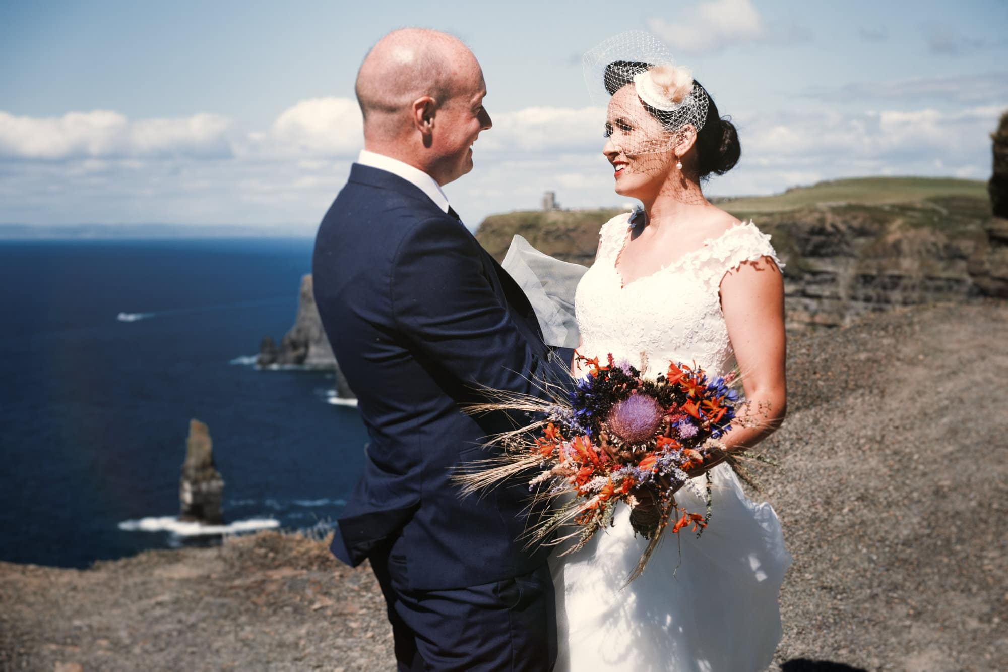 bride and groom at the cliffs of moher