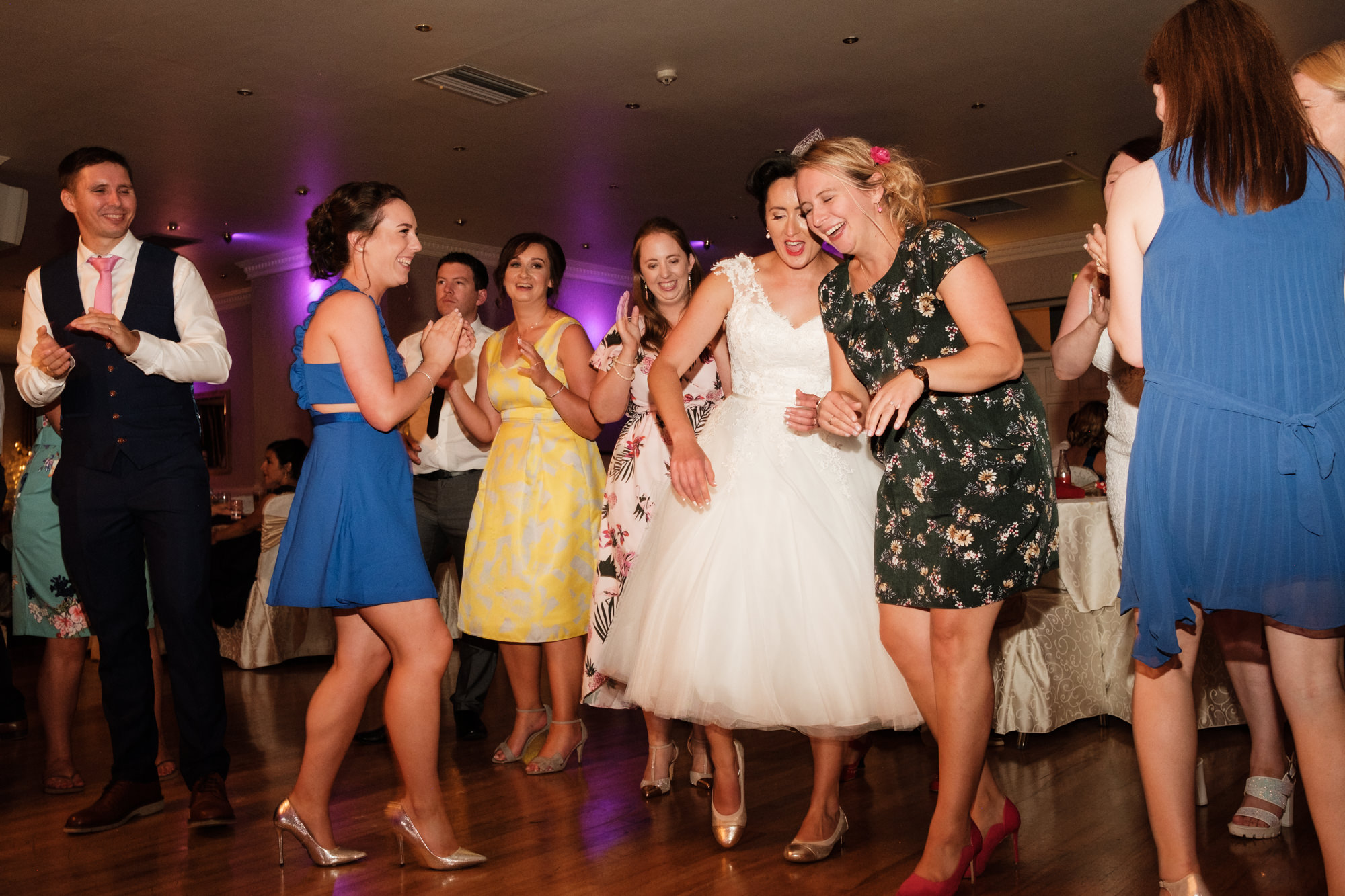 bride dancing with her girlfriends