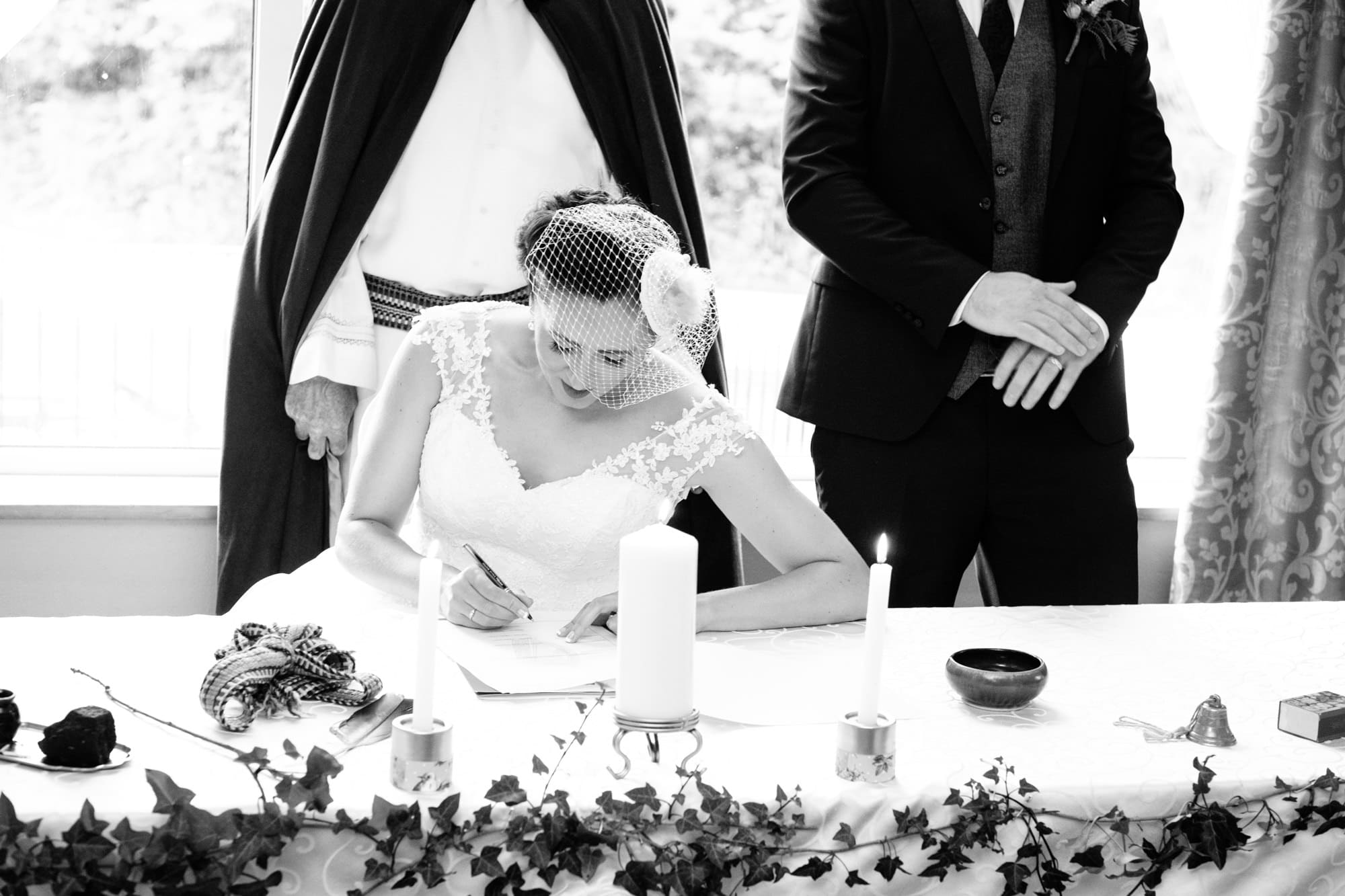 bride signing marriage documents
