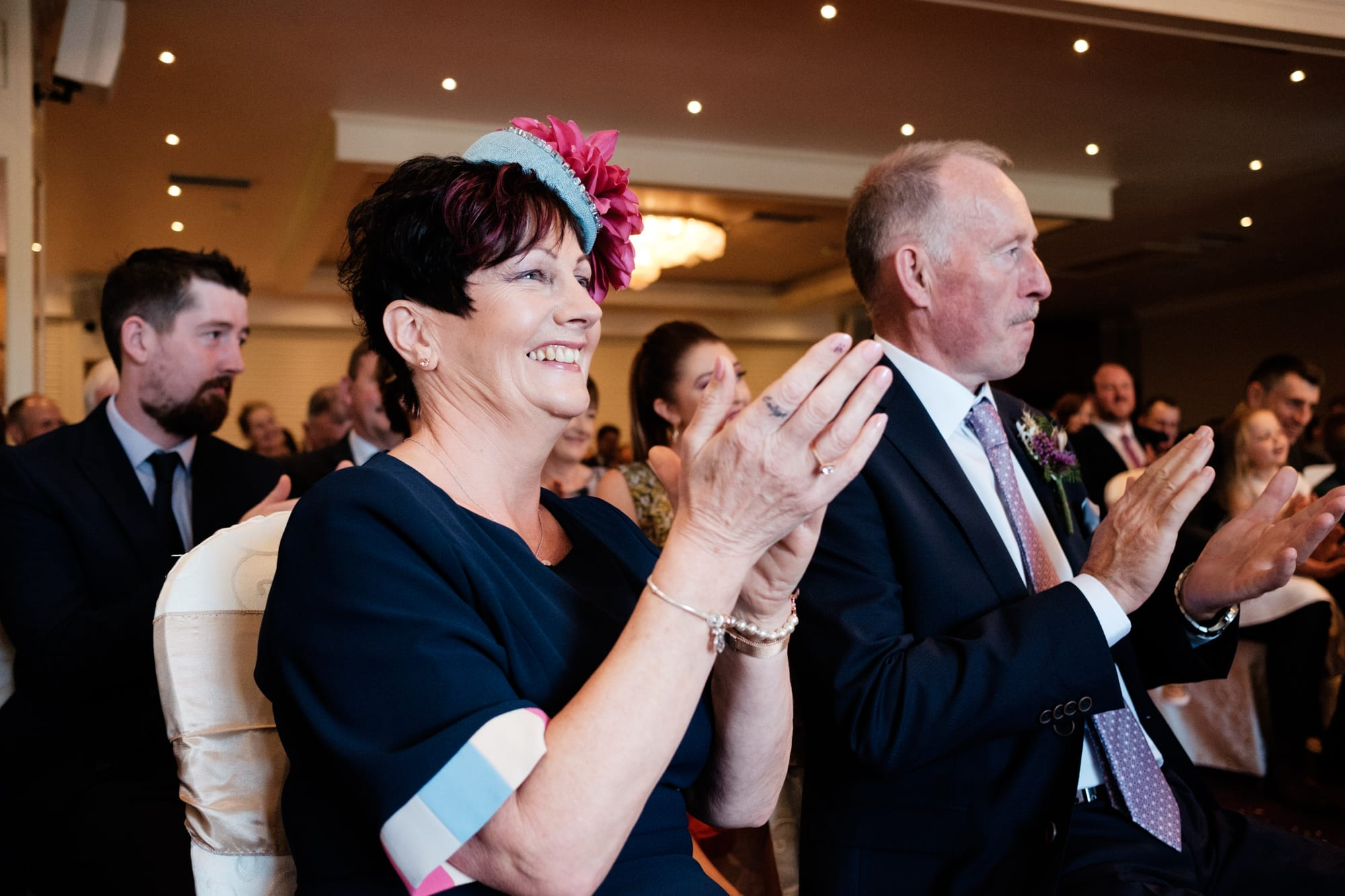 parents clapping at wedding