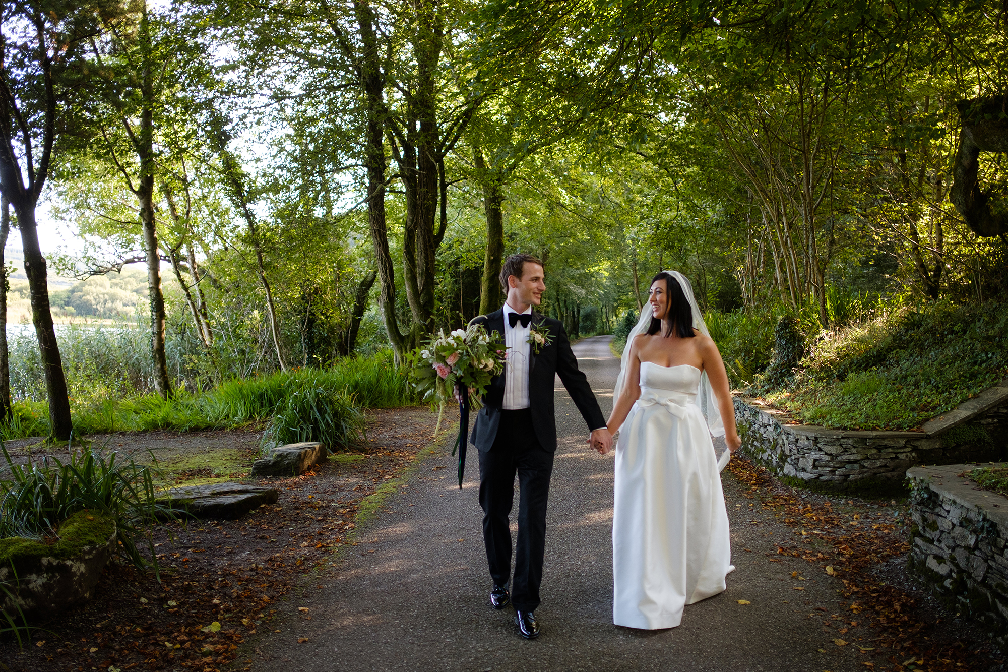 bride and groom walk in liss ard estate