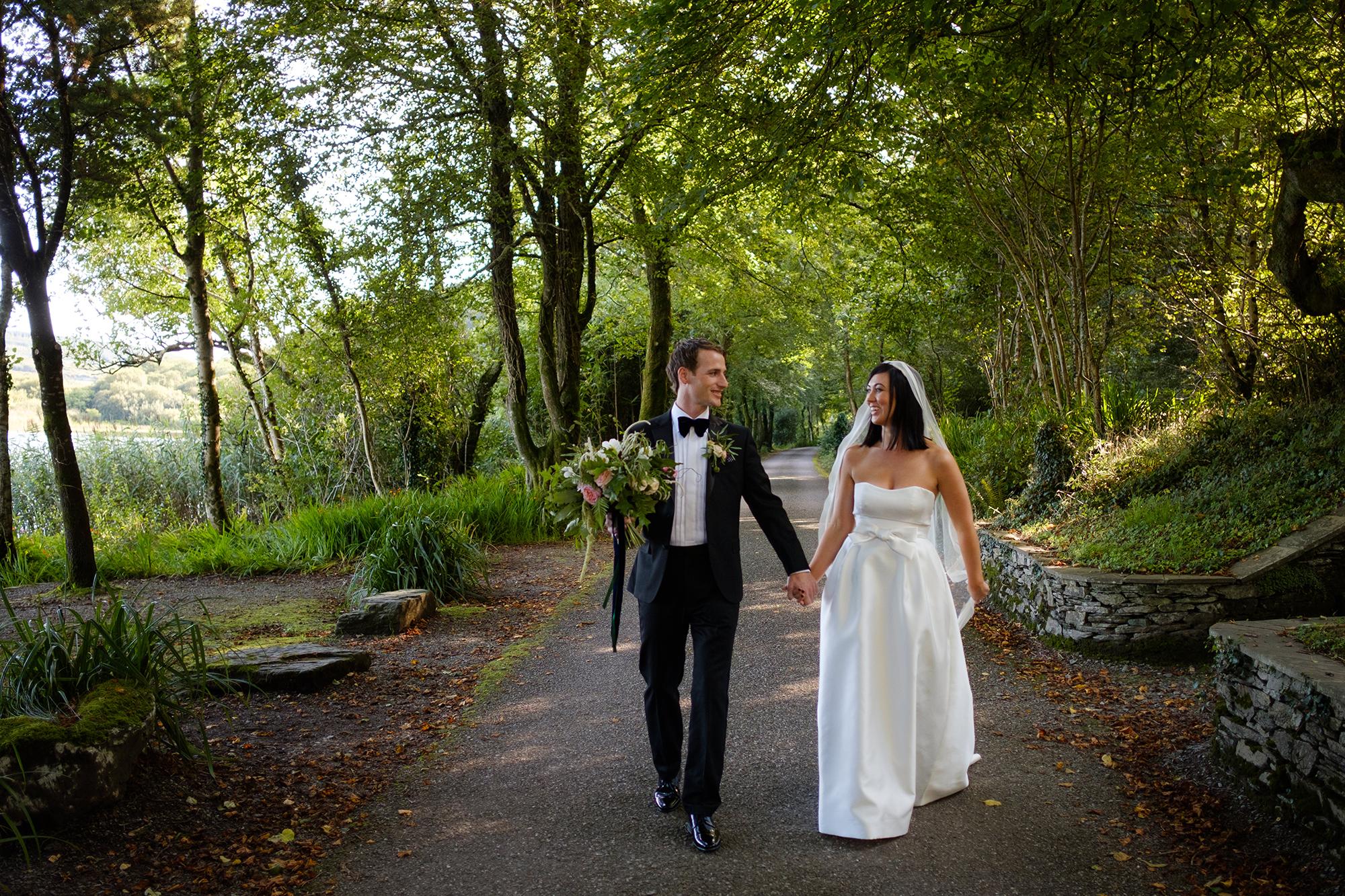 bride and groom walk in liss ard estate