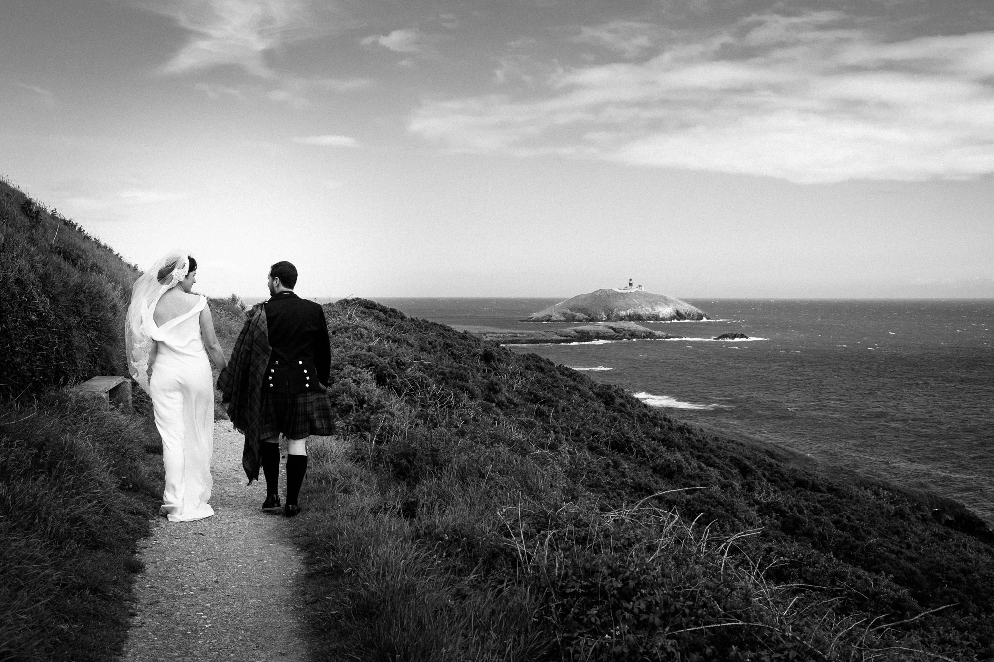 bride and groom on ballycotton cliff walk
