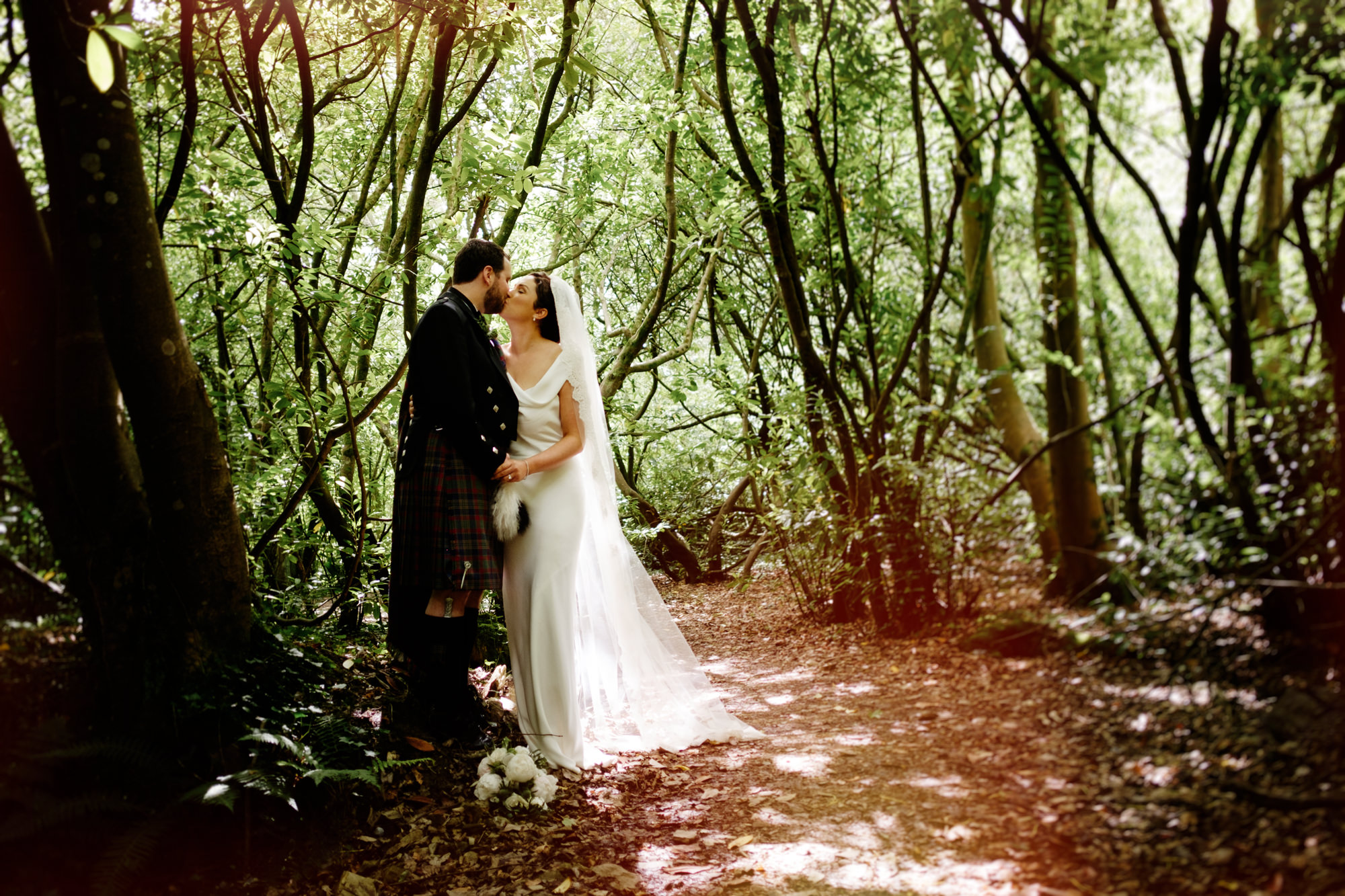 bride and groom in woods at ballymaloe