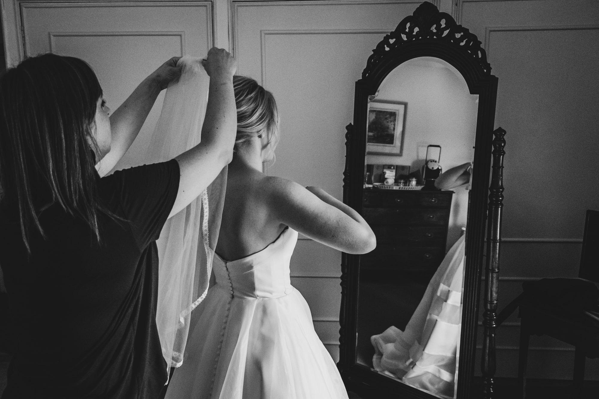 putting on a wedding veil